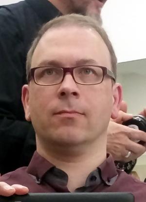 Herr Rau vor Rasur und Haarschnitt